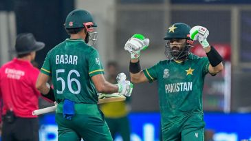Mohammad Rizwan celebrates after reaching his half-century