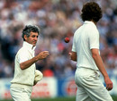 Mike Brearley throws the ball to Bob Willis