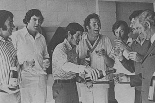 Congdon (pouring the drink) and team toast New Zealand's first Test victory over Australia, in Christchurch