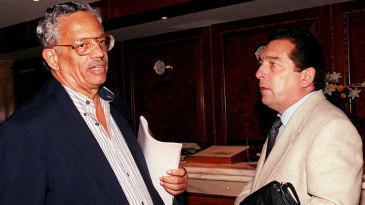 Pat Rousseau (left) chats with Ali Bacher