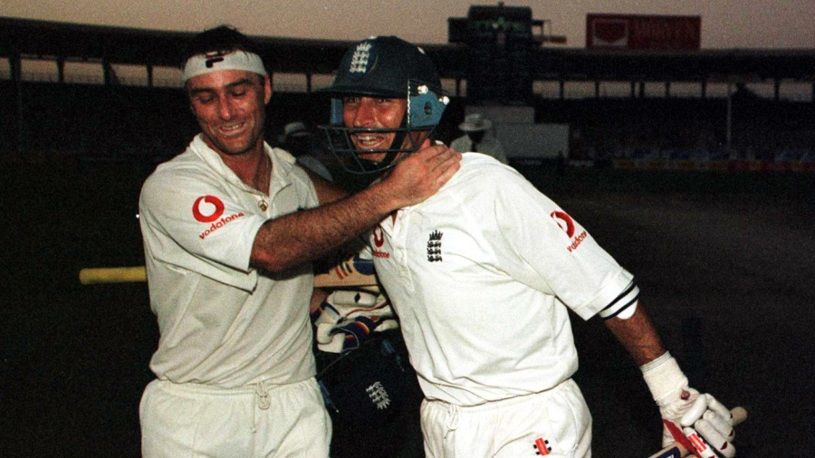 Graham Thorpe and Nasser Hussain celebrate in the Karachi gloom