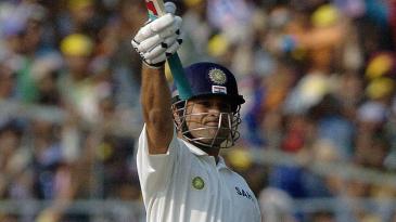 Sachin Tendulkar waves his bat in joy after hitting the winning runs