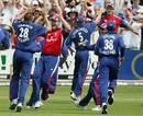 England celebrate the wicket of Damien Martyn