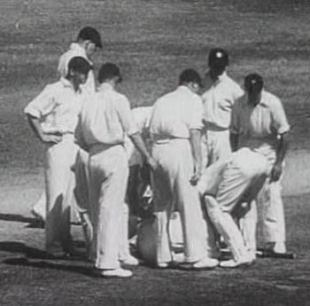 England's fielders crowd round the stricken Bert Oldfield after he was struck by Harold Larwood, Australia v England, 3rd Test, Adelaide, January 16, 1933