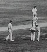 Bill Woodfull is consoled after being struck by Harold Larwood