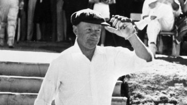 Sir Donald Bradman walks out to bat for the final time