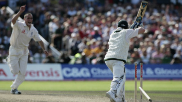 Error of judgement: Michael Clarke is bowled shouldering arms