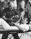 Bernard Thomas, the England physio, tends to Terry Alderman as he is stretchered off, Australia v England, 1st Test, Perth, November 12, 1982