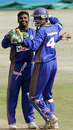 Muttiah Muralitharan and Kumar Sangakkara celebrate after the fall of Mark Boucher in the first match of the Afro-Asia Cup. Asia XI lost out in a low-scoring battle