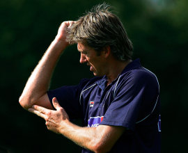 That's where it hurts.  Glenn McGrath nurses his sore elbow during a training session, London, September 1, 2005