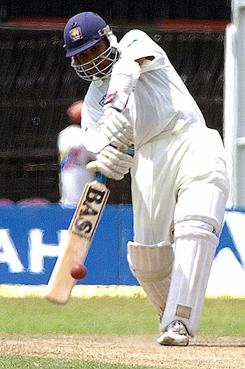 Mahela Jayawardene punches through cover during a low scoring session