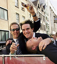 Michael Vaughan holds the urn while Kevin Pietersen and Andrew Flintoff lark about