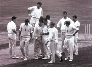 An exhausted  Fred Trueman is congratulated on wicket No. 300