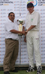 Trent Johnston receives the Intercontinental Cup from Percy Sonn after Ireland's win over Kenya