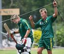 Brett Lee gives Shane Watson a hand as he leaves the nets, Allan Border Field, Brisbane, October 31, 2005