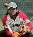 Mahendra Singh Dhoni practises his wicketkeeping ahead of the fourth ODI against Sri Lanka, Nehru Stadium, Pune, November 2, 2005