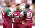 West Indian captain Jimmy Adams (C) discusses with his bowlers Nixon McLean (L) and Laurie William (R) how to stop the onslaught from the Australian batsmen during the 2nd one-day final against the West Indies at the MCG in Melbourne 09 February 2001. Australia amassed the huge total of 338-6 with Mark Waugh topscoring with 173.