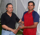 Manoj Cheruparambil accepts the Chris Collins Memorial Cup from Burji Shroff