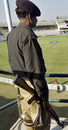 A Pakistani policeman stands guard as England practise, Multan, November 17, 2005