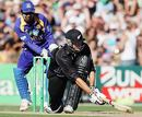 Kumar Sangakarra looks on as Peter Fulton sweeps his way past fifty