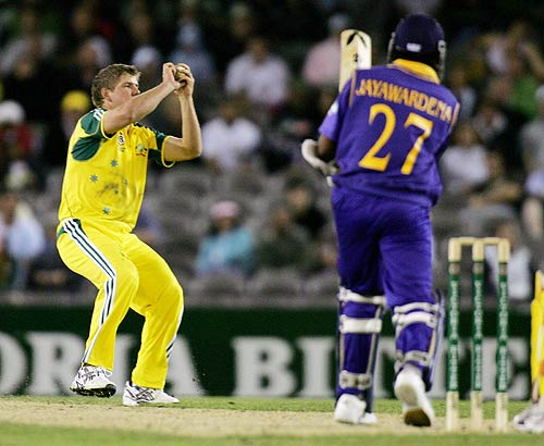 James Hopes take a catch off his own bowling to end Mahela Jayawardene's resistance
