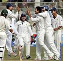 The Indians congratulate Zaheer Khan after Shahid Afridi's wicket, India v Pakistan, 3rd Test, Karachi, 1st day, January 29, 2006