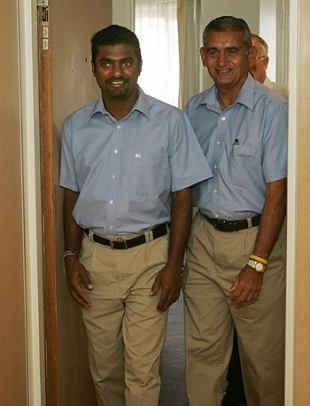 Muttiah Muralitharan and Michael Tissera, Sri Lanka's manager, arrive at a press conference at the University of Western Australia's School of Human Movement, Perth, February 4, 2006