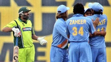A bemused Inzamam-ul-Haq leaves after being given out 'obstructed the field'