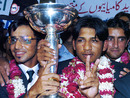 Sarfraz Ahmed, Pakistan's victorious Under-19 captain, and Rameez Raja, return home after winning the World Cup, Karachi, February 21, 2006