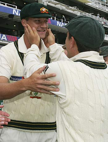 Stuart Clark is congratulated by Justin Langer afer receiving his Baggy Green