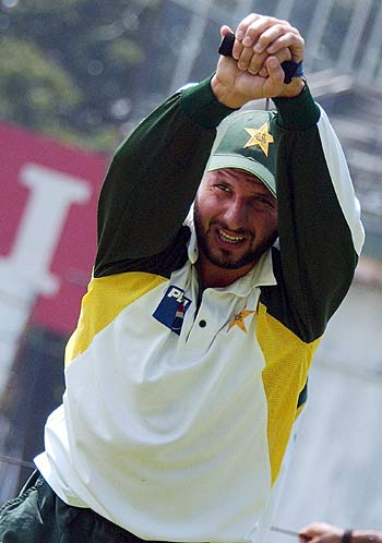 Shahid Afridi stretches during a practice session at the Sinhalese Sports Club, Colombo, March 24, 2006