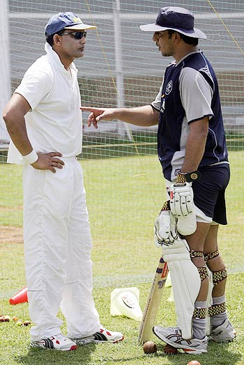 Mohammad Azharuddin and Azhar Mahmood chat during practice at the World Cricket Academy in Mumbai