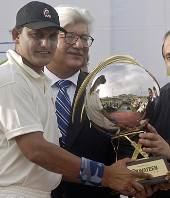 Mohammad Azharuddin holds the winners' trophy after the fourth Pakistan-India Seniors ODI