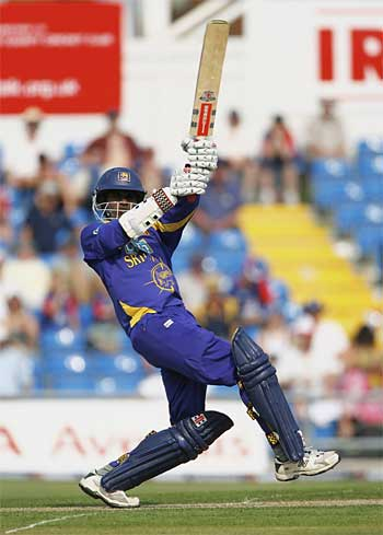 Upul Tharanga hits out on his way to a century and to breaking the record for the highest one-day opening partnership