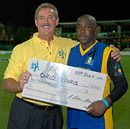 Allen Stanford hands Carlo Morris a cheque for $10,000