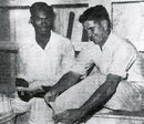 Clairmonte Depeiaza and Denis Atkinson relax during their world record stand, West Indies v Australia, Barbados, May 18, 1955