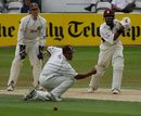 Bilal Shafayat drives past Mark Butcher, Surrey v Northants, The Oval, August 2, 2006
