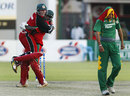 Brendan Taylor  and Blessing Mahwire celebrate as a dejected Mashrafe Mortaza trudges away, Zimbabwe v Bangladesh, 3rd ODI, Harare, August 2, 2006