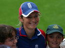 Charlotte Edwards is surrounded by fans and autograph hunters