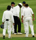 Vanburn Holder examines the pitch after it was hit by a water bomb, Lancashire v Warwickshire, County Championship, Blackpool, August 30, 2006