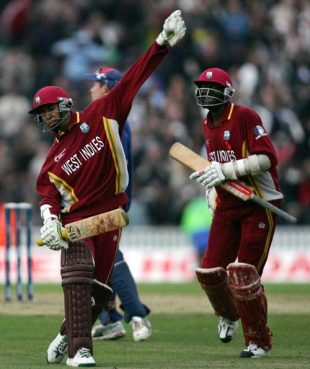 Ian Bradshaw and Courtney Browne celebrate a thrilling one-wicket win in the finals of the Champions Trophy, The Oval, September 25, 2004