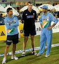 Suresh Raina, John Buchanan and Rahul Dravid share a moment after India's exit from the DLF Cup, Australia v India, 6th match, DLF Cup, Kinrara Oval, Kuala Lumpur, September 22, 2006