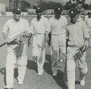 Len Hutton, having recorded the highest score by an England captain in a Test match of 205, and Johnny Wardle return to the pavilion for the tea interval during their seventh-wicket partnership of 102 in the fifth Test at Sabina Park, Jamaica, eventually won by England to square the series, March 1954