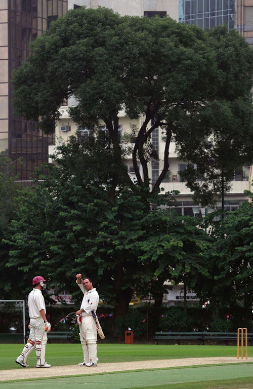 MCC batsmen take a breather during a match in Hong Kong