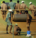 Groundstaff at the Brabourne Stadium work on the pitch, Mumbai, October 17, 2006