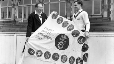Stuart Surridge and Peter May pose with the 1952 Championship pennant