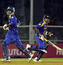 Upul Tharanga and Mahela Jayawardene during the course of their 89-run stand , Sri Lanka v New Zealand, 5th match, Champions Trophy, Mumbai, October 20, 2006