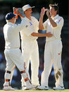 Glenn McGrath is congratulated on removing Alastair Cook
