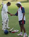A jubilant Gus Logie congratulates Saleem Mukuddem after he had added an unbeaten seventh-wicket stand of 213 with David Hemp, Netherlands v Bermuda, Intercontinental Cup, Pretoria, November 23, 2006
