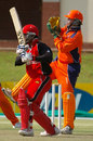 Ashish Bagai drives during his fifty against Netherlands